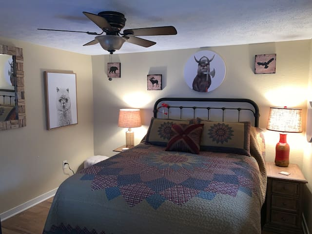 This is the bedroom with a queen size bed. Underneath the nigh table, you can charge two smart phones and there is an Epson printer available if you wish to print or scan some documents.