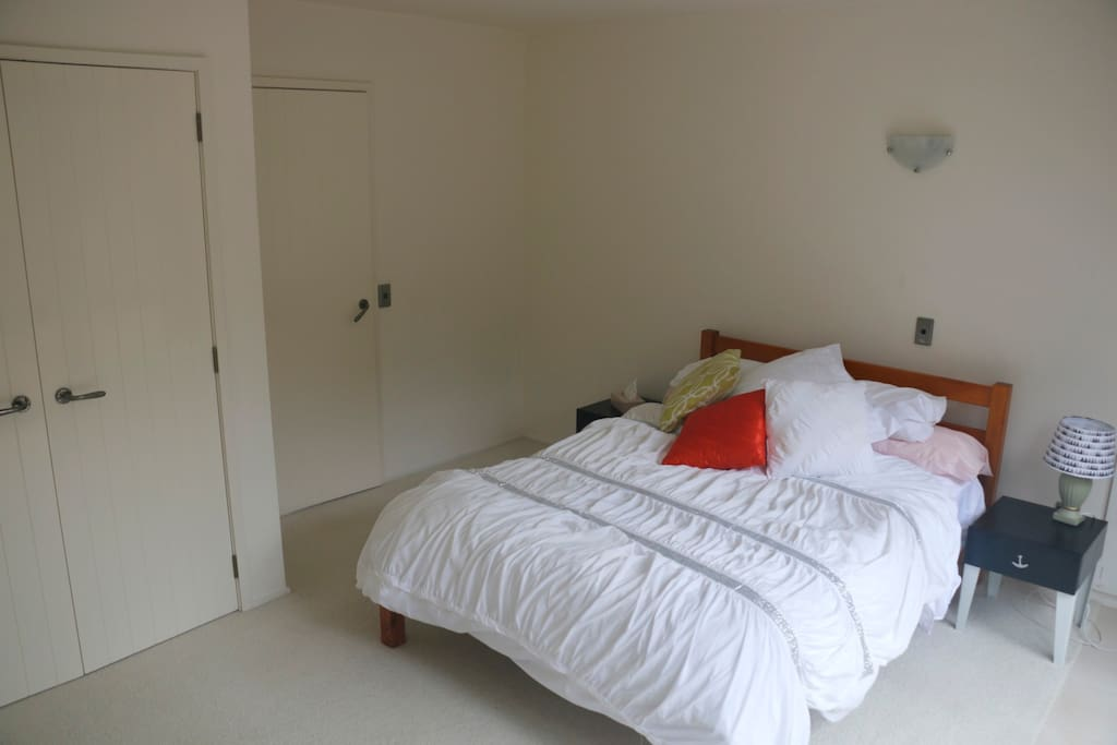 Large bedroom, with double bed and built in wardrobe.  Private courtyard.