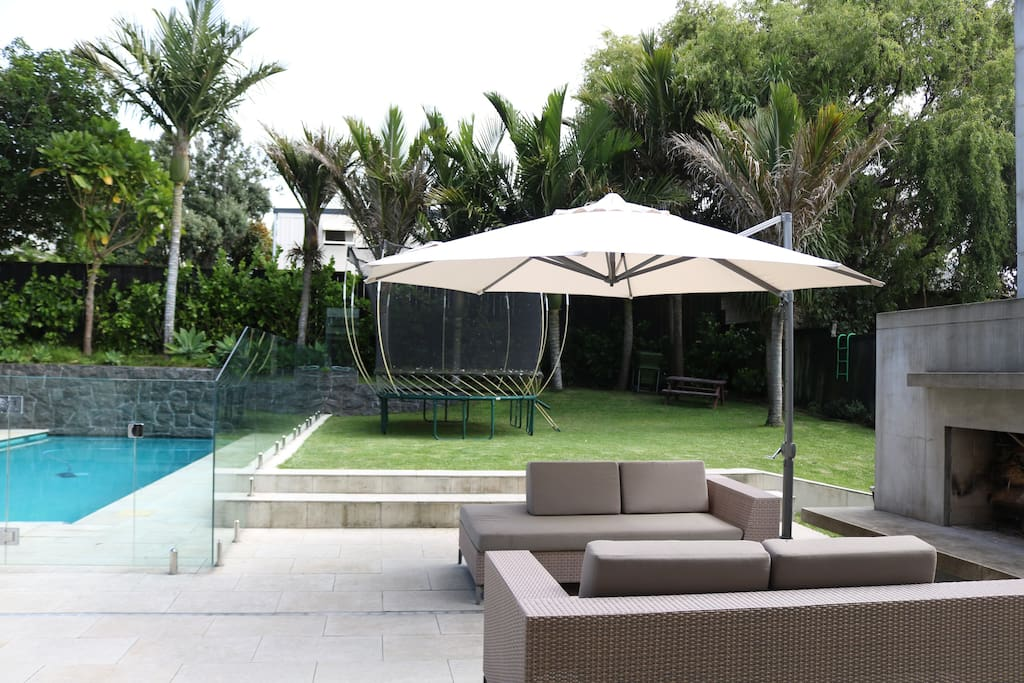 Stunning poolside relaxation, surrounded by greenery.
