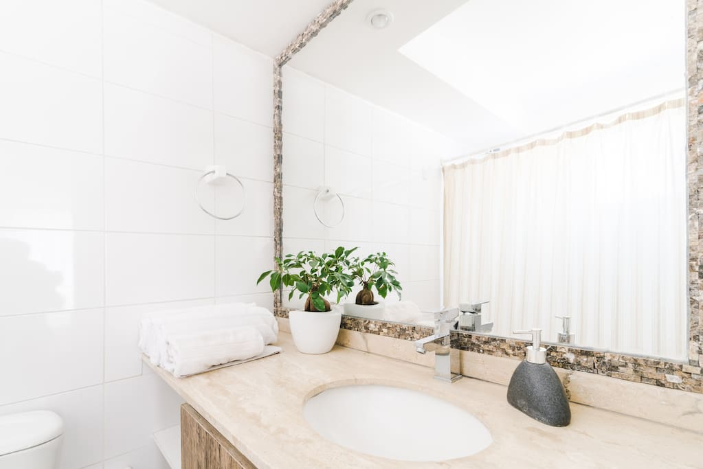 The bathroom features marble countertops, and a shower/tub combo with good hot water pressure.