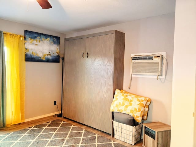 The murphy bed retracts into the wall to ensure more room when it is not in use.