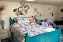 Cozy ocean themed studio offers mini kitchenette, comfy chairs, a writing desk, and lots more!