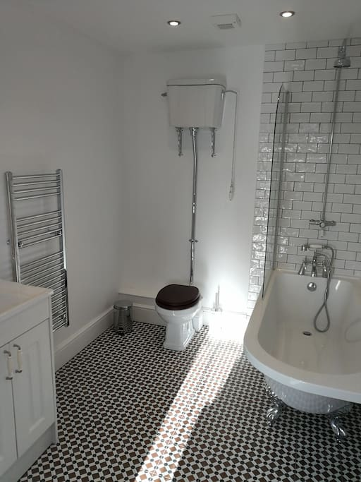 Tudor Cottage bathroom with high level cistern toilet and over-bath shower