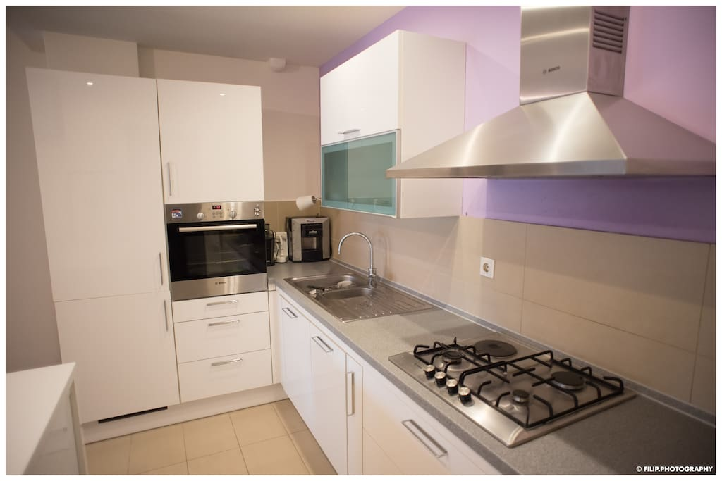 Kitchen fully equipped with dishwasher, oven, cooker and all utensils