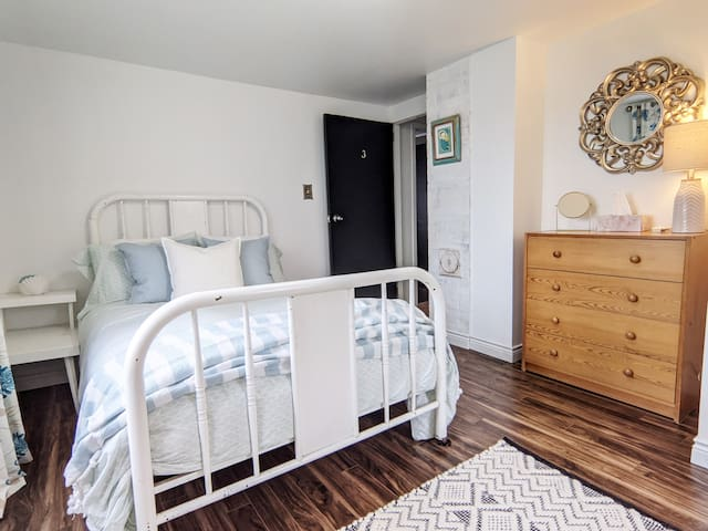 Bedroom 4 with double bed and reading area