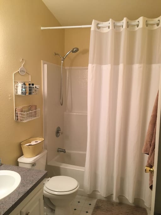 Private bath with shower and tub. All towels and toiletries included.