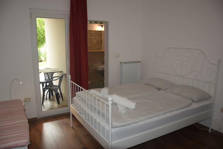 Piran bedroom with sofa