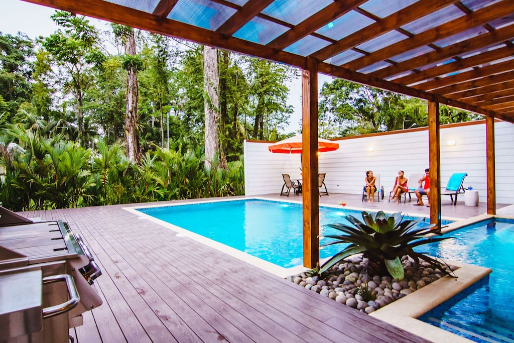 Pool with BBQ, chairs, sun bathing chairs
