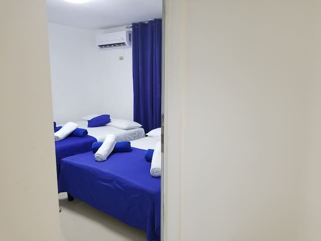 entrance to the first room, fully air-conditioned, with two double beds, and extra blankets in case you need them