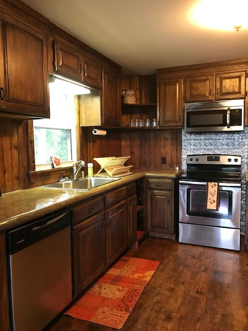 Full Kitchen with Concrete Counter Tops