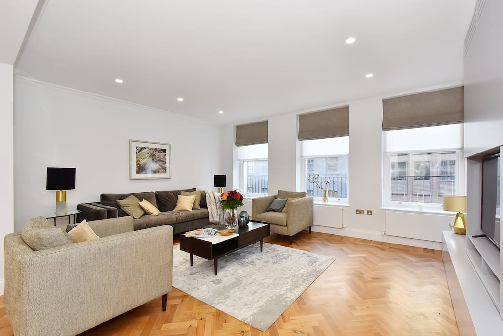 The elegant newly furnished Lounge with large sofa and 2 armchairs