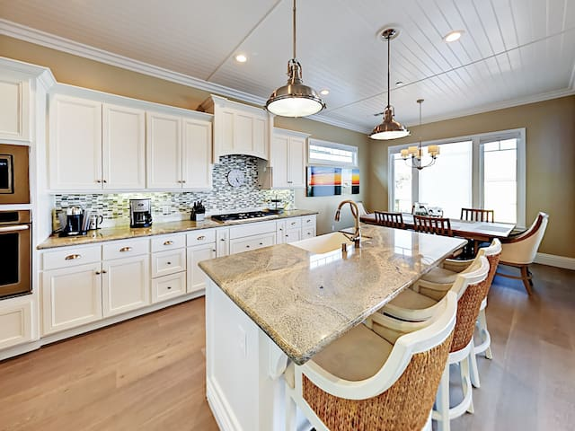 Whip up meals in the kitchen, outfitted with granite countertops and stainless steel appliances.