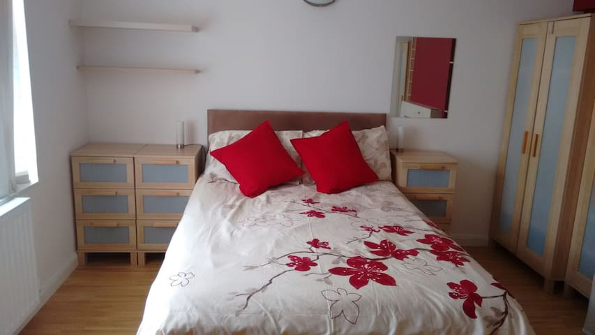 Large double bedroom in quiet house.