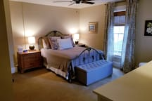 Large quiet bedroom with walkin closet and comfortable queen size bed. Ample storage space.