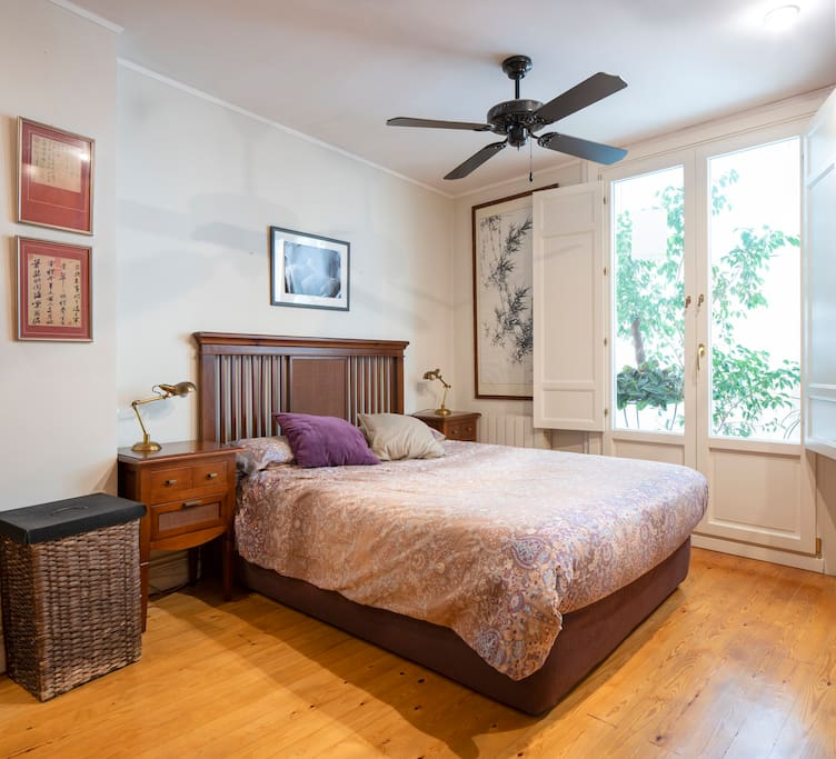 Double bed with balcony and fan