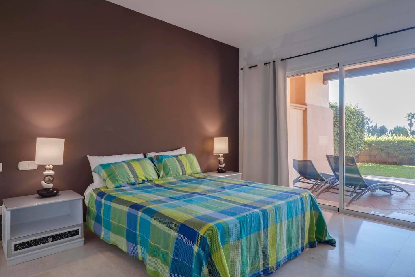 Master bedroom which opens out onto the terrace,gardens and pools.