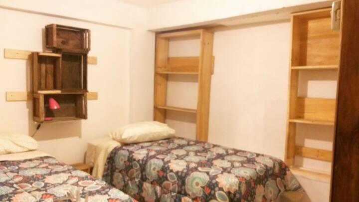 Casa Tokerau dormitorio doble dos camas