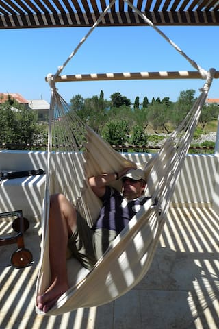 Hanging chair with direct seaview