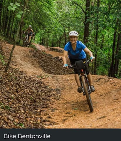 Bikeing in Bentonville is huge! We have some of the best trails with all degrees of difficulty and hundreds of miles of trails. Bentonville and the connecting trails that cover all of Northwest Arkansas has been named top 10 in the United States for biking this year! (2017)   PS :  ACCESS TO THE BENTONVILLE BIKE TRAILS IS JUST 30 SECONDS FROM YOUR DRIVE WAY for Mountain bikers it connects to all the trails! You can get on your bike and in no time while going through lush beautiful scenery be at the Square!