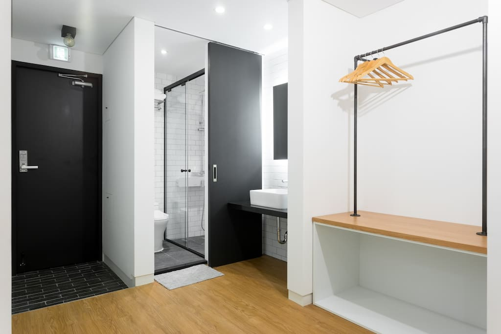 The bathrooms include separate backlit mirrors and washbasins to allow couples to more efficiently prepare in the morning.