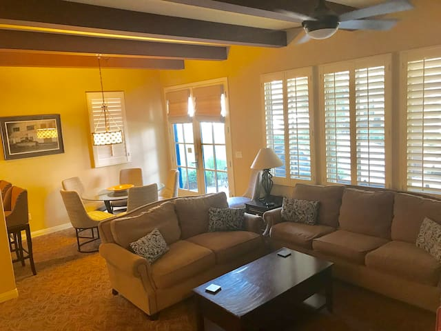 open living area as well as dining and bar stools for extra seating.  French doors that lead out to the covered patio.