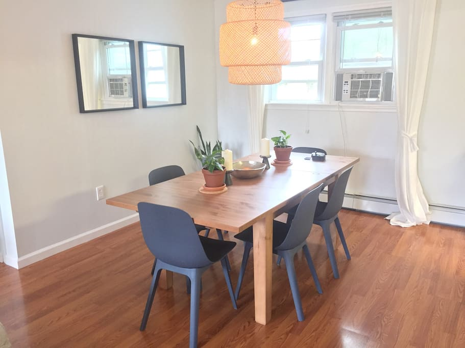 Dining table fits 6 comfortably, 8 or more can squeeze with extra chairs (provided)