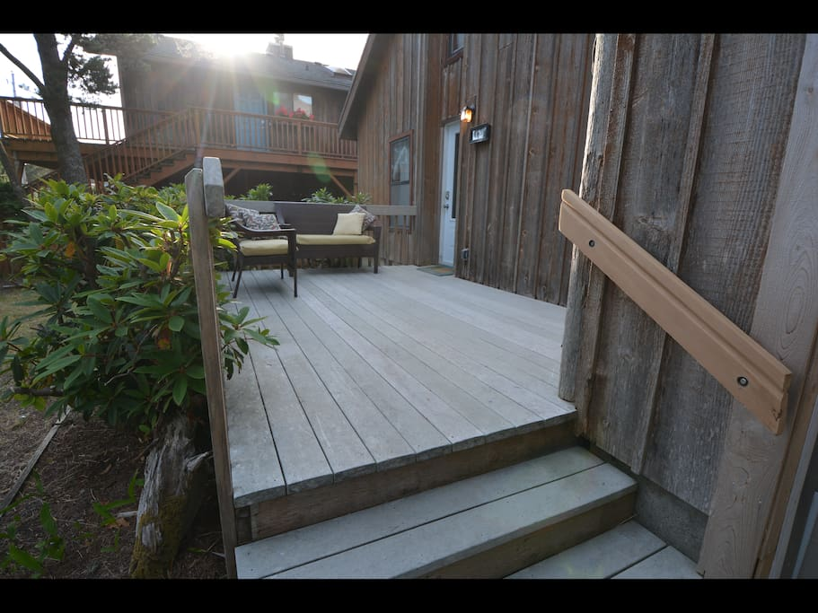 Front entrance deck and fully fenced yard.