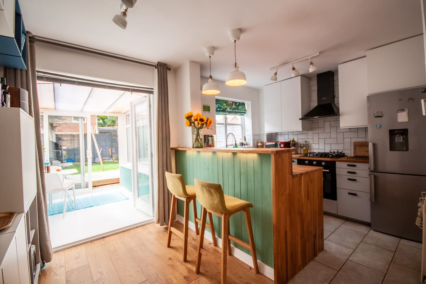 Open plan modern newly fitted kitchen with solid wood breakfast bar