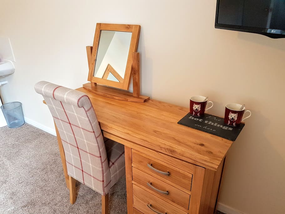 Matching oak dressing table has drawers for storage. In this room you have a built in wardrobe in the alcove.