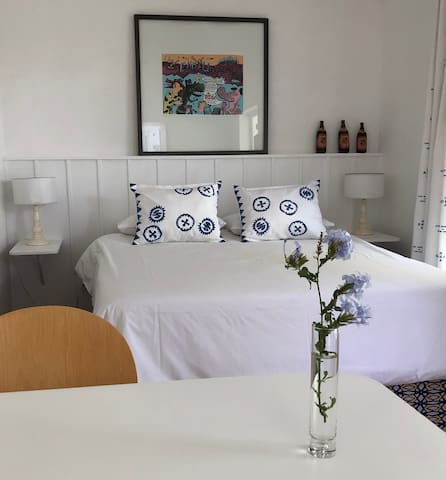 Bright, airey, uncluttered, super clean room with queen size bed.