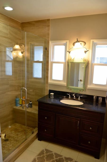 Shared, large bathroom with glass shower