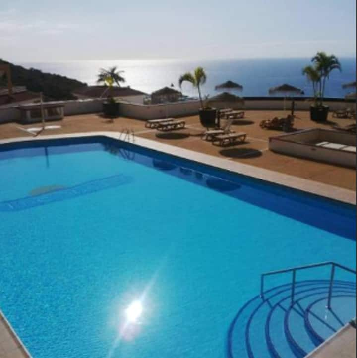 House with 3 bedrooms in Costa Adeje, with wonderful sea view, shared pool and furnished terrace