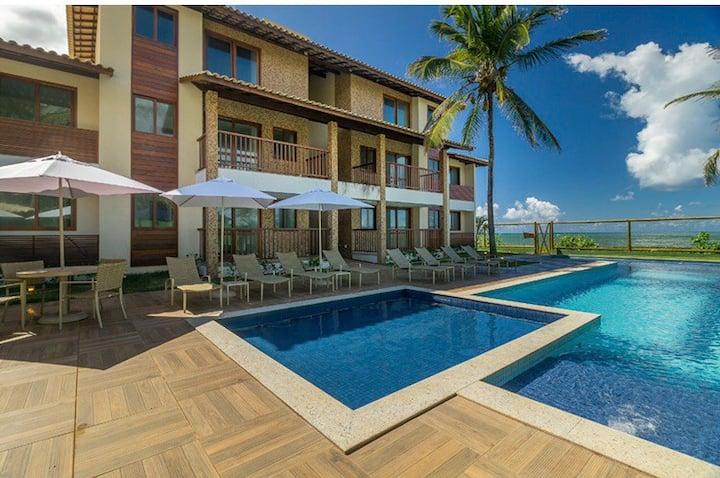 Village Itacimirim 2/4 com uma suite , pé na areia