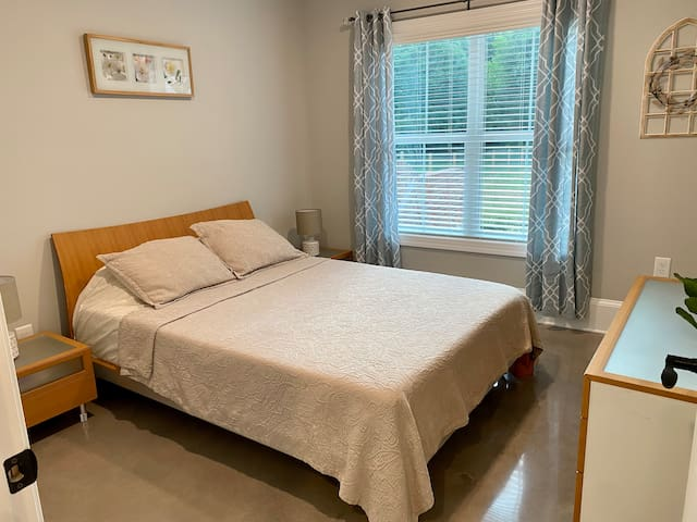 Bedroom with queen size bed and new memory foam mattress. Large window for natural light and lookout to the yard. Blinds and curtains for privacy.