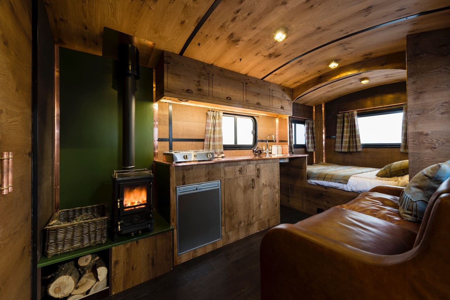 Gorgeous luxury interior. Pippy oak, copper work tops, wood burner and cosy sleigh bed.