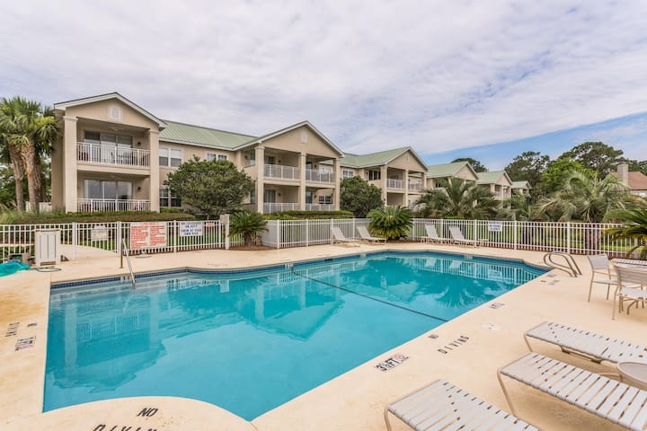 Stylish condo with marsh-facing balcony and shared pool!