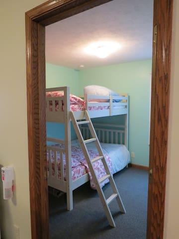 Bedroom #2 features 2 full beds