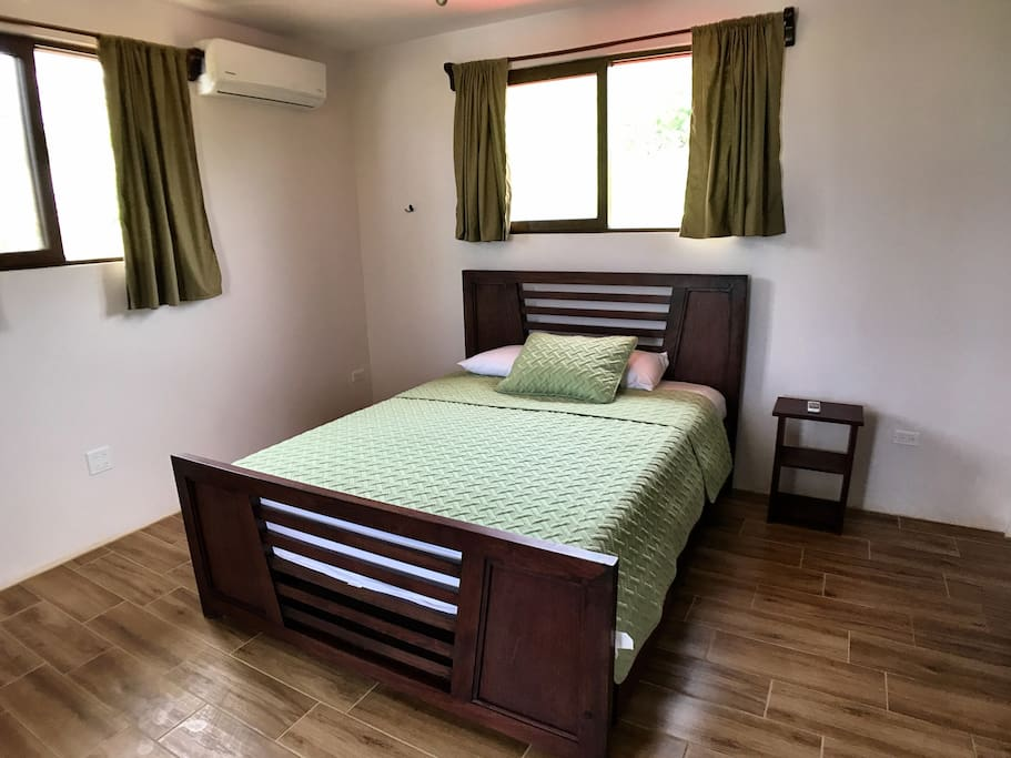 Spacious bedroom with Queen bed, private bathroom and Air Conditioning
