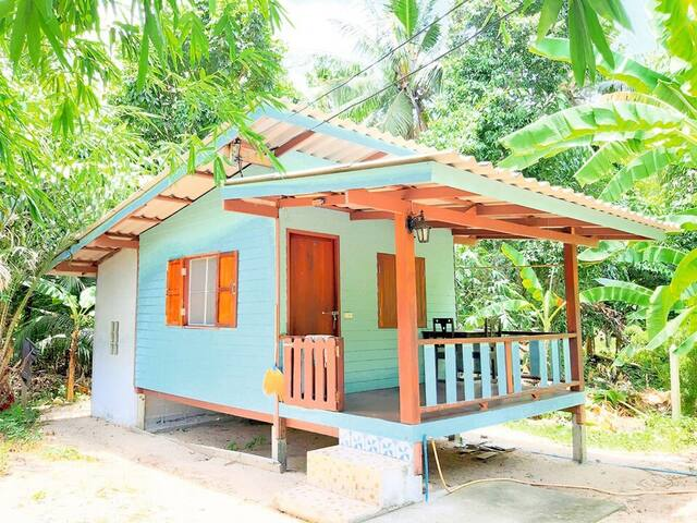 Peaceful blue house in the Jungle