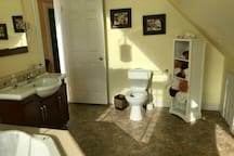 Upstairs washroom and two person hot tub