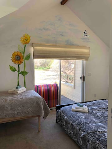 Sunflower room overlooking the orchard with detached bathroom and private balcony.