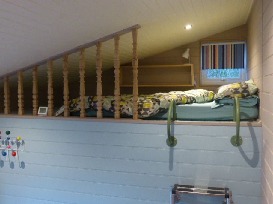 Sleeping deck showing access ladder and hand rails.