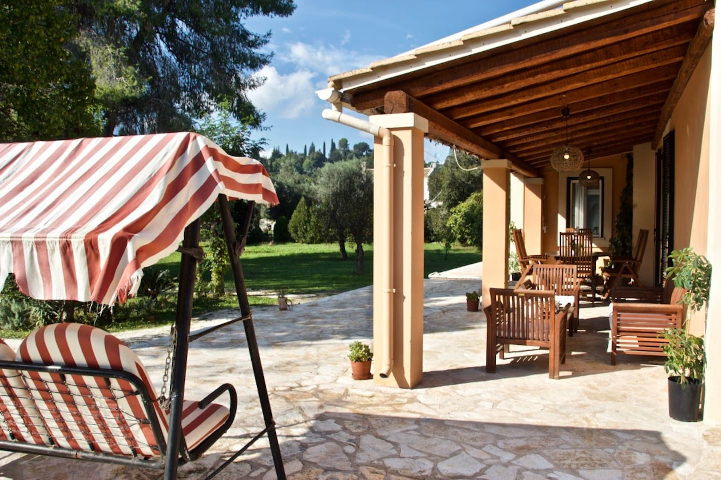 The  villa's porch invites the guests to sit and relax, surrounded by nature.