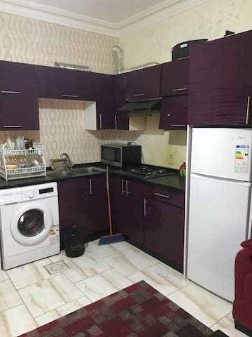 Fully furnished kitchen equipped with gas cooker , fridge , washing machine, fumes exhaust fan and all other kitchen equipments