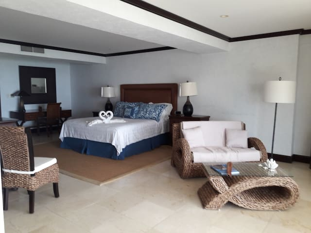 Master bedroom.  Very spacious and comfortable . It has a flat screen TV It has access to the terrace overlooking the see