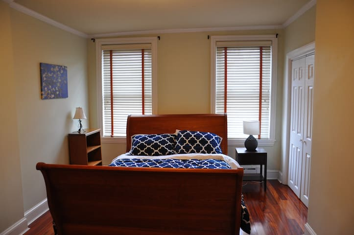 Master bedroom with queen-sized bed. There's an extra full mattress under the bed and plenty of floor space to use it. There are two single floor mattresses in the closet that can easily be moved to/used on the second bedroom floor.