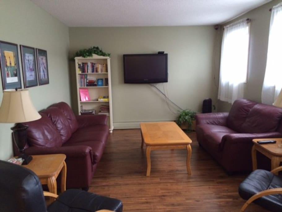Lounge with hardwood flooring