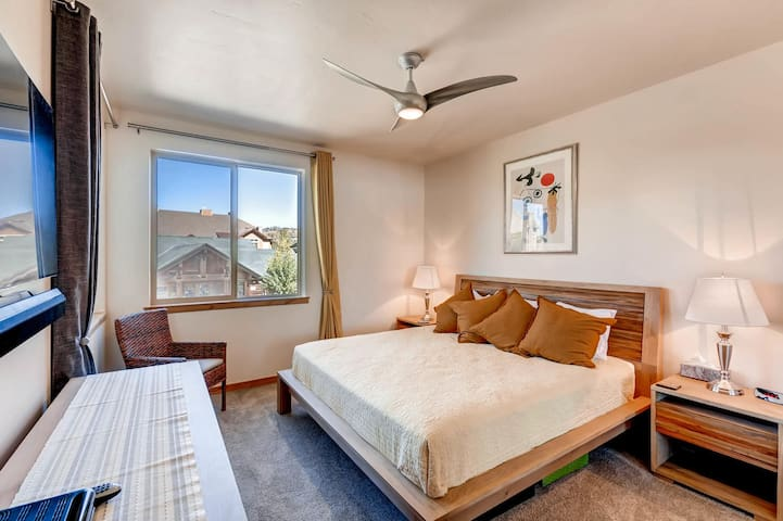 Master bedroom with 55 inch TV, king bed.