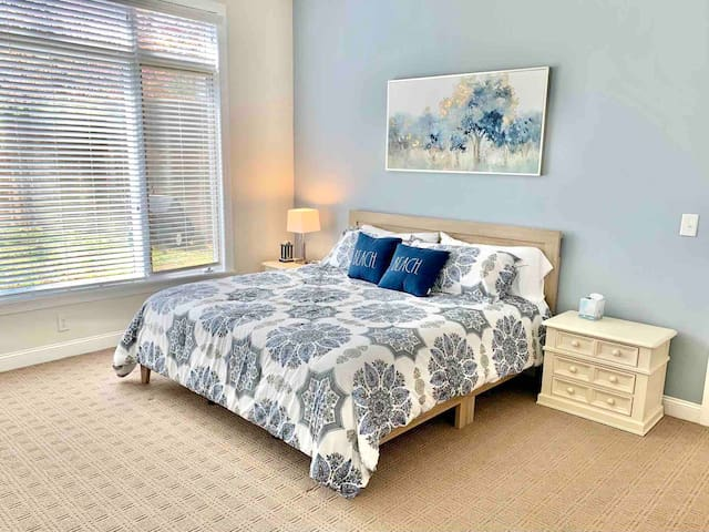 Bedroom 2 with King bed and smart TV.