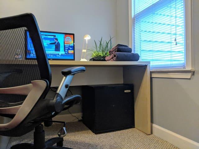 Workstation with desk lamp & mini fridge.